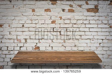 Antique Wooden Shelf on Brick Wall. Old Shelf. Shelf on the Wall. Shelf in Vintage Style Blank Shelf. Old Board Old Rack. Wooden Bookshelf. Grunge Wall Brick Empty Shelf. Brick Background.