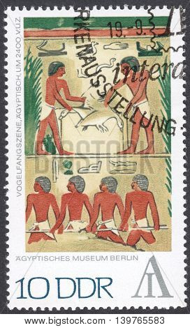 MOSCOW RUSSIA - CIRCA FEBRUARY 2016: a post stamp printed in DDR shows fowling scene Egypt the series