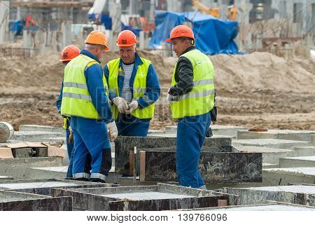 Tobolsk, Russia - July 15. 2016: Sibur company. Construction of plant on processing of hydrocarbonic raw materials. Workers do base under big oil tank