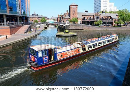 BIRMINGHAM, UNITED KINGDOM - JUNE 6, 2016 - View of The Malt House pub at Old Turn Junction with a tour boat in the foreground Birmingham England UK Western Europe, June 6, 2016.