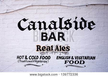 BIRMINGHAM, UNITED KINGDOM - JUNE 6, 2016 - Canalside bar sign painted on a brick wall in Gas Street Basin Birmingham England UK Western Europe, June 6, 2016.