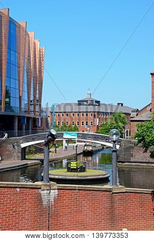 BIRMINGHAM, UNITED KINGDOM - JUNE 6, 2016 - View along the canal at Old Turn Junction with the National Indoor Arena to the left hand side Birmingham England UK Western Europe, June 6, 2016.