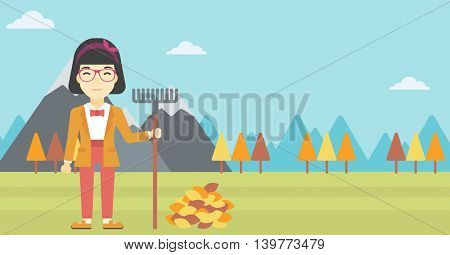 An asian young woman raking autumn leaves. Woman with rake standing near tree and heap of autumn leaves. Woman tidying autumn leaves in garden. Vector flat design illustration. Horizontal layout.