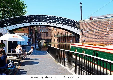 BIRMINGHAM, UNITED KINGDOM - JUNE 6, 2016 - Pavement cafe alongside the canal at Gas Street Basin Birmingham England UK Western Europe, June 6, 2016.