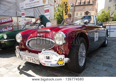 Nurnberg Bavaria / Germany - July 19th 2014: red Austin-Healey 3000 MK II sport vintage car at Sud - Rallye- Historic event in Nurnberg