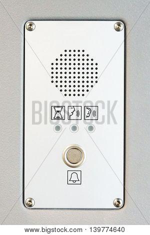 Modern intercom panel built in a metal wall.