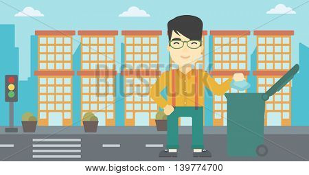 An asian young man throwing away a garbage in a green trash in the city. Man throwing away trash. Eco-friendly man throwing trash. Vector flat design illustration. Horizontal layout.
