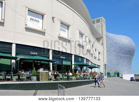 BIRMINGHAM, UNITED KINGDOM - JUNE 6, 2016 - View of a pavement cafe with the Selfridges building in the Bullring to the rear Birmingham England UK Western Europe, June 6, 2016.