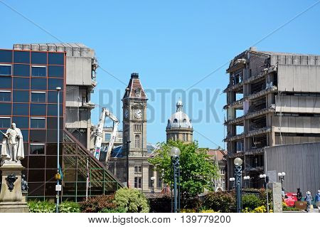 BIRMINGHAM, UNITED KINGDOM - JUNE 6, 2016 - View from Centenary Square past the old library being demolished towards the art gallery clock tower and Council House dome Birmingham England UK Western Europe, June 6, 2016.