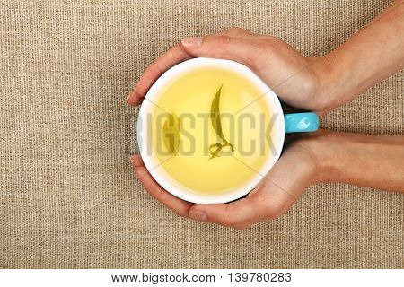 Two Woman Hands Holding Cup Full Of Green Tea