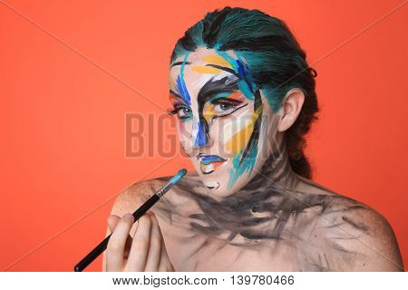 Creative Colorful Beauty Portrait of Intense Make Up Cosmetics
