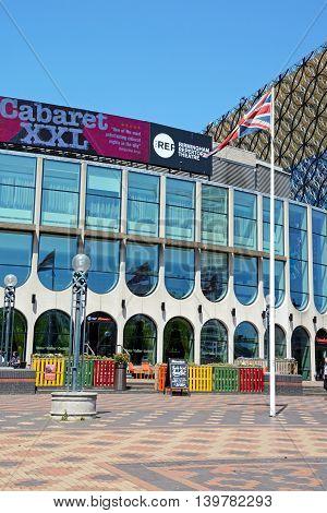 BIRMINGHAM, UNITED KINGDOM - JUNE 6, 2016 - Birmingham Repertory Theatre in Centenary Square with a British flag in the foreground Birmingham England UK Western Europe, June 6, 2016.