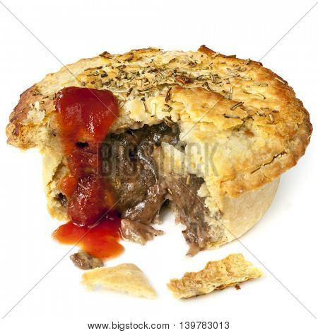 Meat pie isolated on white.  Bite out, with tomato sauce.  Lamb with rosemary.