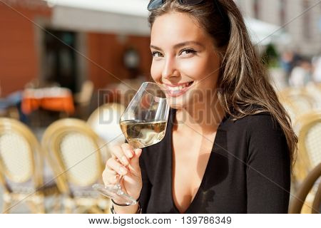 Brunette Beauty Having Wine Fun.