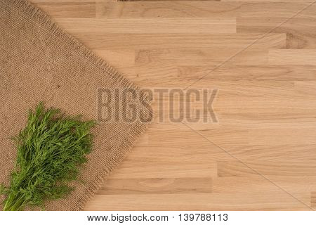 Dill on a wooden background.Dill on a wooden background.