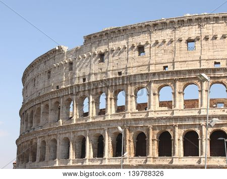 Great Colosseum in Rome, Italy, Europe. Roman Coliseum close-up with clear blue sky.