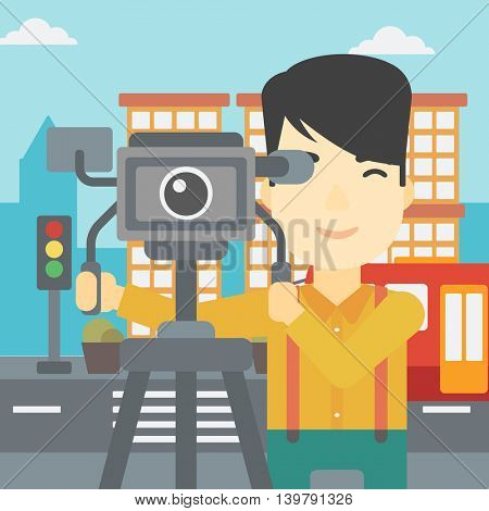 An asian young cameraman looking through movie camera on a tripod. Young man with professional video camera in the city. Vector flat design illustration. Square layout.