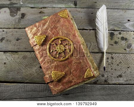 Mystic and magic book with fairy tales and white quill