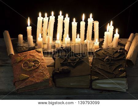 Decorated magic book with burning candles, Hallowen concept