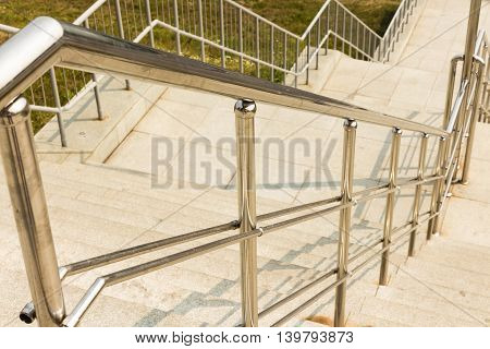 Beautiful stainless steel handrails are installed on the walls and stepsstainless steel handrail