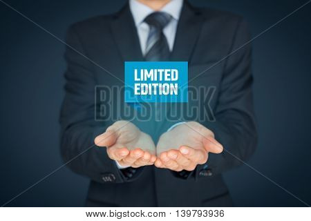 Limited edition concept - exclusive business model and marketing offer. Businessman hold virtual label with text limited edition.