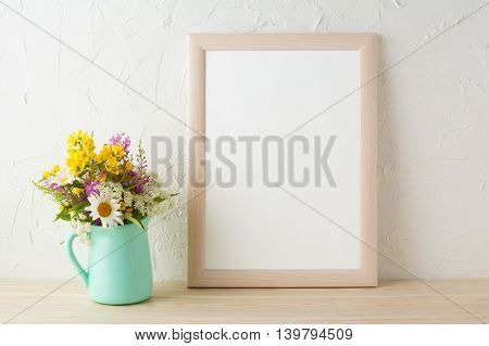 Frame mockup with tender flowers in mint green vase. Poster white frame mockup. Empty white frame mockup for presentation design.