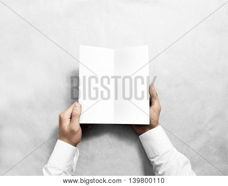 Hand opening blank white flyer brochure booklet mockup. Leaflet presentation. Pamphlet mock up holding hand. Man show clear offset paper. Booklet design template. Paper sheet display read first person