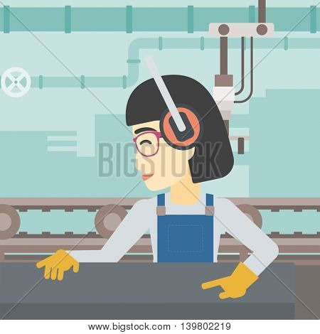 An asian woman working on metal press machine. Worker in headphones operating metal press machine at workshop. Woman using press machine. Vector flat design illustration. Square layout.