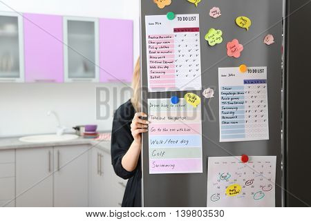 Calendar and to do lists hanging on refrigerator