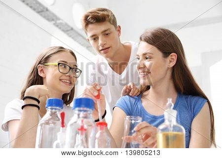 Lesson chemistry, chemical experiments. Schoolgirl performs chemical experience.