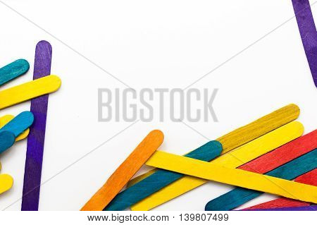 Colorful Popsicle Sticks Over White Background With Copy Space