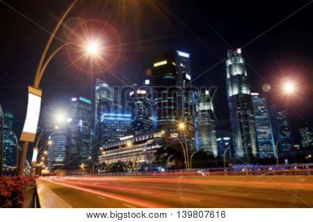 The beauty of car lights and street lighting with lens flare effect at night on the road in the city.