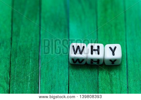 Why Cube Blocks Arranged On Green Wooden Background