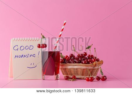 Sweet Cherries In A Basket And Glass Of Juice On Pink  Background