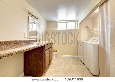 Laundry And Bathroom Interior In Soft Tones With Tile Floor.