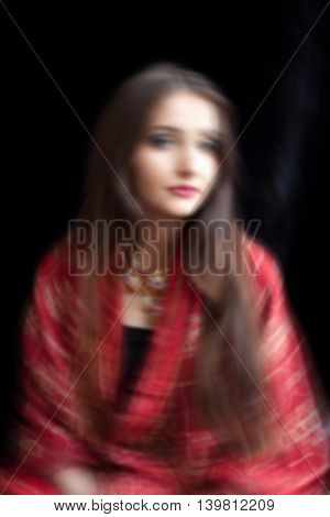 Artistic portrait of a Indian Woman with movement adn blur