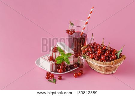 Glass Of Cherry Juice With Fresh Cherries Berry On Pink Background.