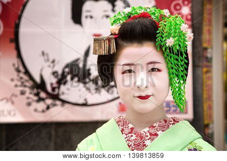 KYOTO, JAPAN - June 16 2016: Geisha on the streets of Gion. In Kyoto, Japan 2016