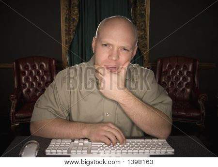 Thinking Man Looking At Computer