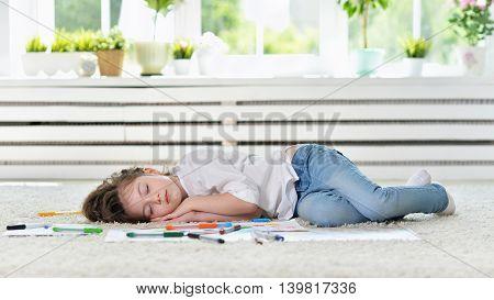 Cute student girl sleeping during art class