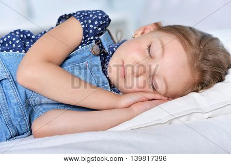Portrait of a cute little girl sleeping in bed