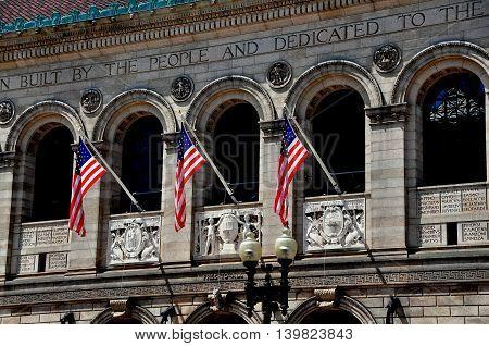 Boston Massachusetts - July 14 2013: Italianate Renaissance facade of the 1888 Boston Public Library in Copley Square designed by McKim Mead and White