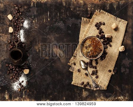 Coffee composition on dark rustic background with space for text