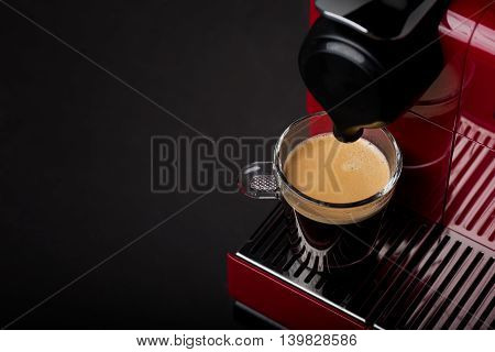 Cup of freshly brewed coffee from new coffee maker