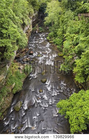 Ohio's Cuyahoga River flows through a rocky gorge in the community of Cuyahoga Falls.