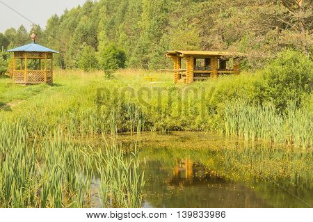Wooden summerhouse on edge of a forest wood near by small lake