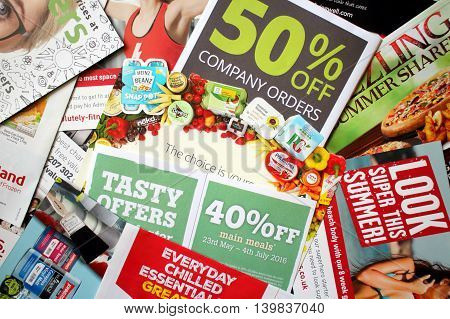 LONDON, United Kingdom - JULY 25: Sample of junk mail items delivered to a private residence in England as advertising for local retail businesses and services