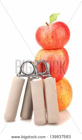 two carpal expander and a stack of three red apples with green leaf on white background fitness concept