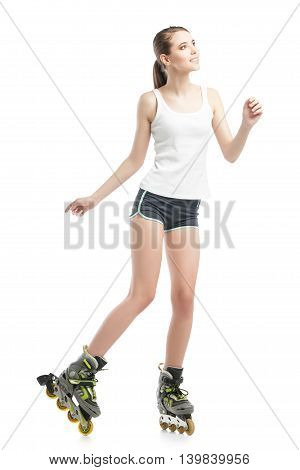 young pretty woman on roller skates. studio shot