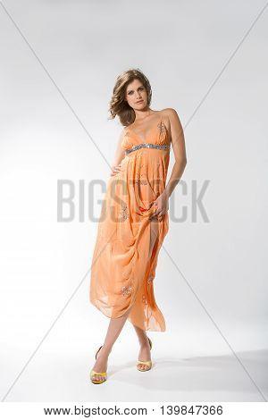 Lady Posing In Long Dress Like Peach And Walking